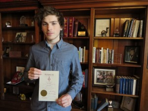 Frank Quigley poses with his certificate of induction into the Phi Sigma Tau philosophy honor society.