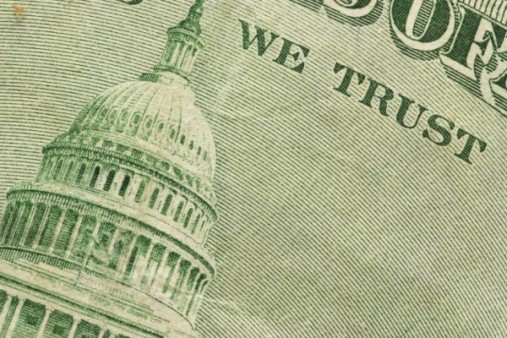 close up of the capitol building on a United States bank note