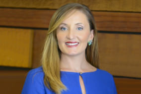 Head shot of Senior Fellow Francesca Spidalieri smiling at the camera