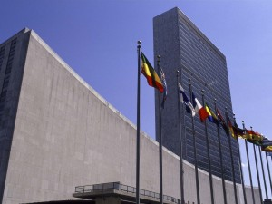 Image of the front of the United Nations headquarters in New York City.