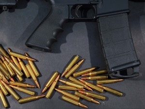 In this photo illustration, a Rock River Arms AR-15 rifle is seen with ammunition on December 18, 2012 in Miami, Florida.