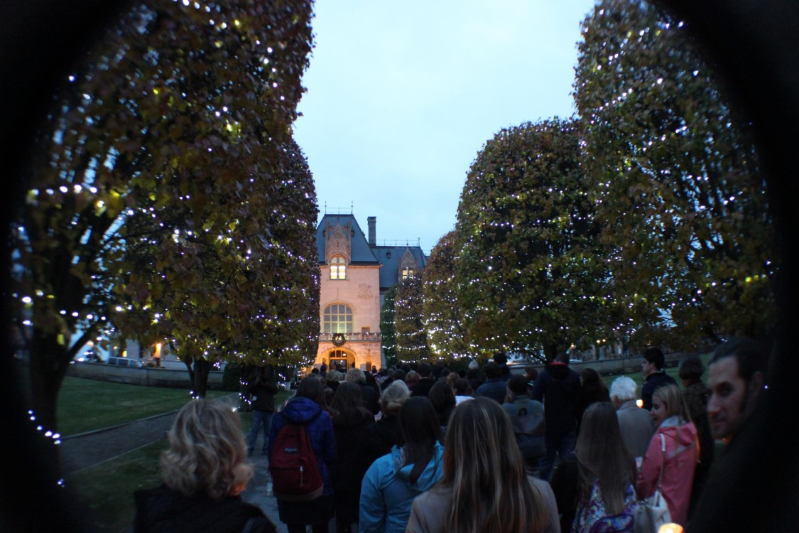 Students file through the gates and into the building of Ochre Court with candles in hand after attending the gate-opening ceremony for the Jubilee Year of Mercy.
