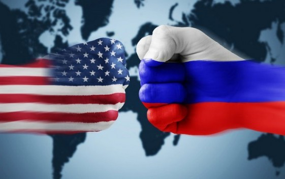 Image featuring fists painted with the American and Russian flags about to clash into one another upon a world map.