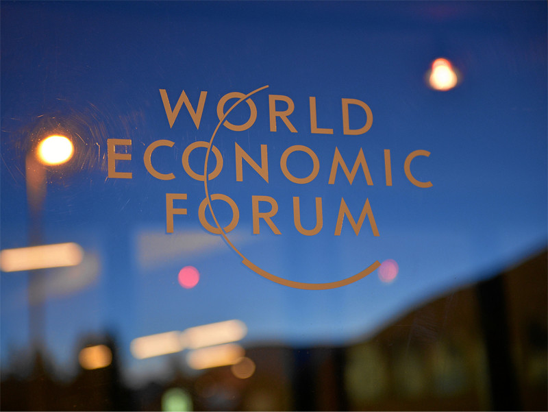 Emblem of the World Economic Forum on a window in Geneva.
