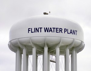 Photograph of a white water plant tower in Flint, Michigan.