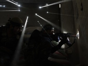 Pulitzer Prize winning image taken by Javier Manzano of Syrian rebel soldiers guarding their position as light streams through bullet holes in a wall.