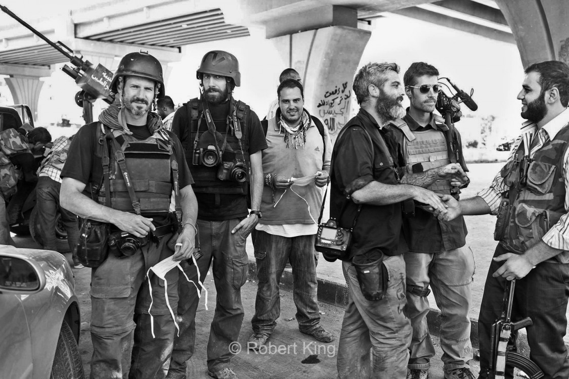 Photograph of Pell Center Prize Winner, Javier Manzano, among colleagues in Aleppo, Syria.