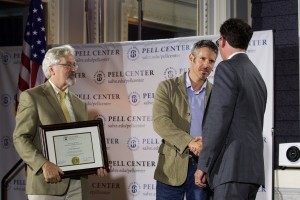 Pell Center Executive Director Jim Ludes shakes hands with Pell Center Prize winner Javier Manzano as the Providence Journal's G. Wayne Miller presents the award.
