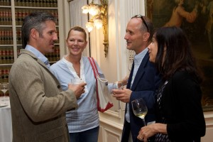 Pell Center prize winner Javier Manzano speaks with audience members at the reception following his acceptance speech.
