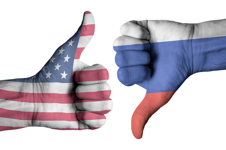 Russia and American Flags on Human Hands
