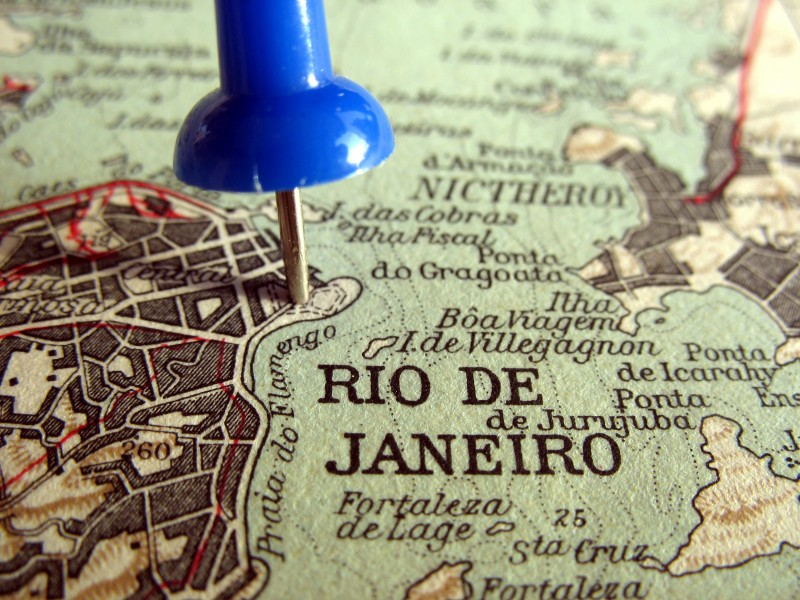 Closeup of world map zoomed up to Rio de Janeiro with a pin The