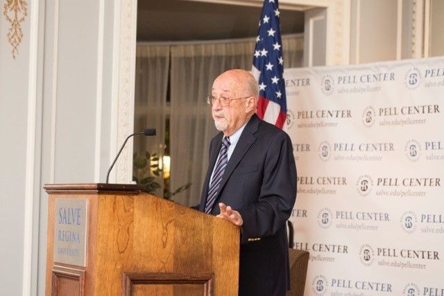 Mario DiNunzio, professor emeritus at Providence College, stands at the Salve Regina podium.