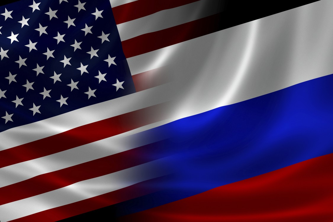 Merged US and Russian flag on satin texture. Concept of the long historical and political relations between the two countries.