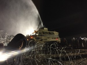 Tank sprays water cannons
