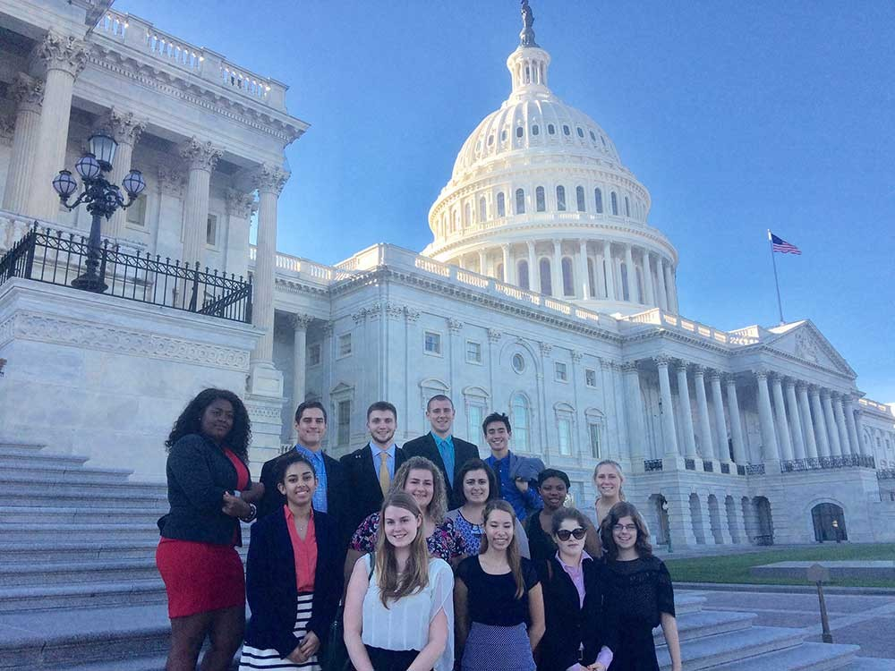 Nuala Pell Leadership Fellows pose on steps of the capitol building