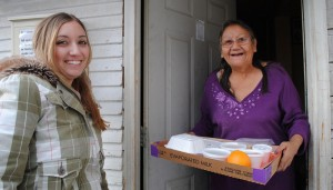 Woman receives a delivery from Meals on Wheels