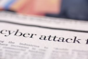 "The words ""cyber attack"" in newspaper print"
