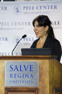 Daphne Matziaraki, a Greek documentary filmmaker, at the podium at Salve Regina University.