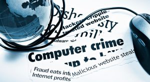 Clippings of computer crime headlines with computer mouse cord wrapped around a globe