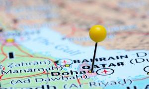 Map with yellow pin stuck in Doha, Qatar